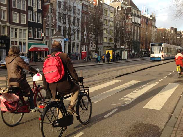 A complete street can take many different forms. Here's one example of a complete street that includes protected bike lanes, transit and wide sidewalks. The new policy is not about accommodating every mode on every street but about planning complete networks for walking, biking and transit. Photo by Annie Van Cleve.