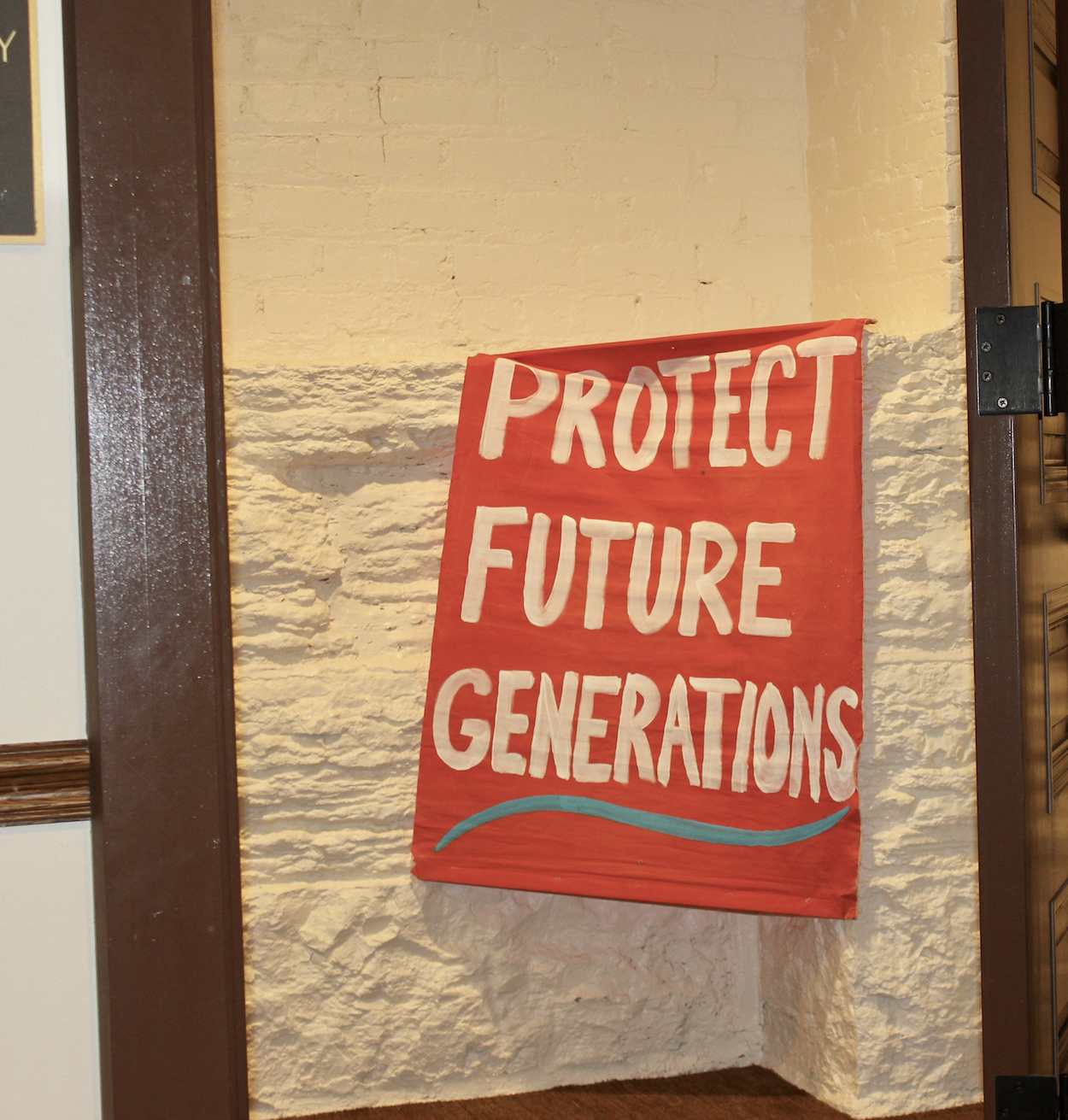 A banner calling for action on climate change outside the press conference debuting the Minnesota Green New Deal. Photo by Andrew Hazzard.