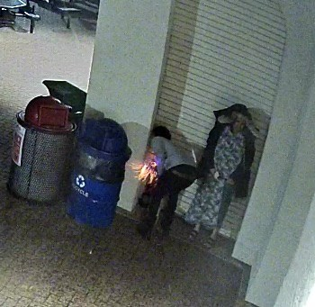 Surveillance photo released by Minneapolis Police shows a male suspect police are seeking in the fire that destroyed the pavilion at Bde Maka Ska and a female companion who is no longer considered a person of interest. Submitted image